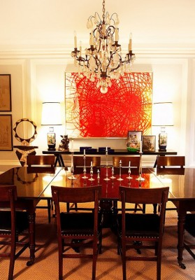 PHOTO: Todd Selby  Traditional furniture and a crystal chandelier face off against eye-catching contemporary art in the New York apartment of fashion designer Kate Spade and branding exec Andy Spade.