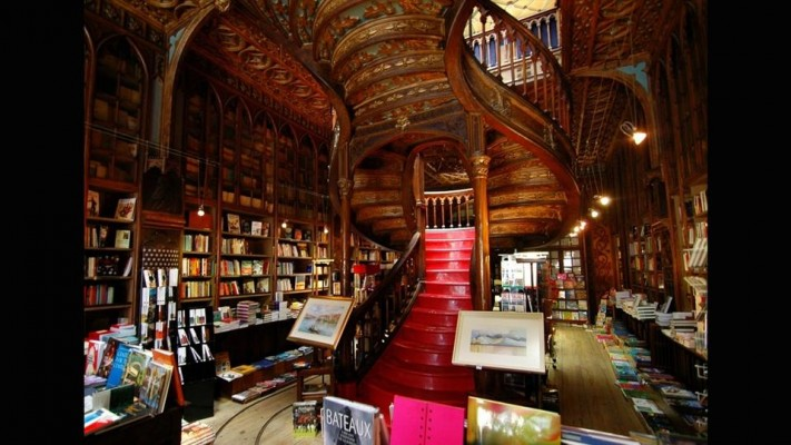 Livraria Lello, Porto This Portuguese landmark opened in the former Chardron Library at the turn of the 19th Century. Its Art Nouveau space is dominated by a curving staircase with ornate wooden carvings to match its intricate wall panels and columns.