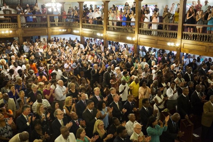 Parishioners applaud during a memorial service at Morris Brown AME Church for the people killed Wednesday during a prayer meeting inside a historic black church in Charleston, S.C., Thursday, June 18, 2015. Police arrested 21-year-old suspect Dylann Storm Roof Thursday in Shelby, N.C. without resistance. (AP Photo/David Goldman)