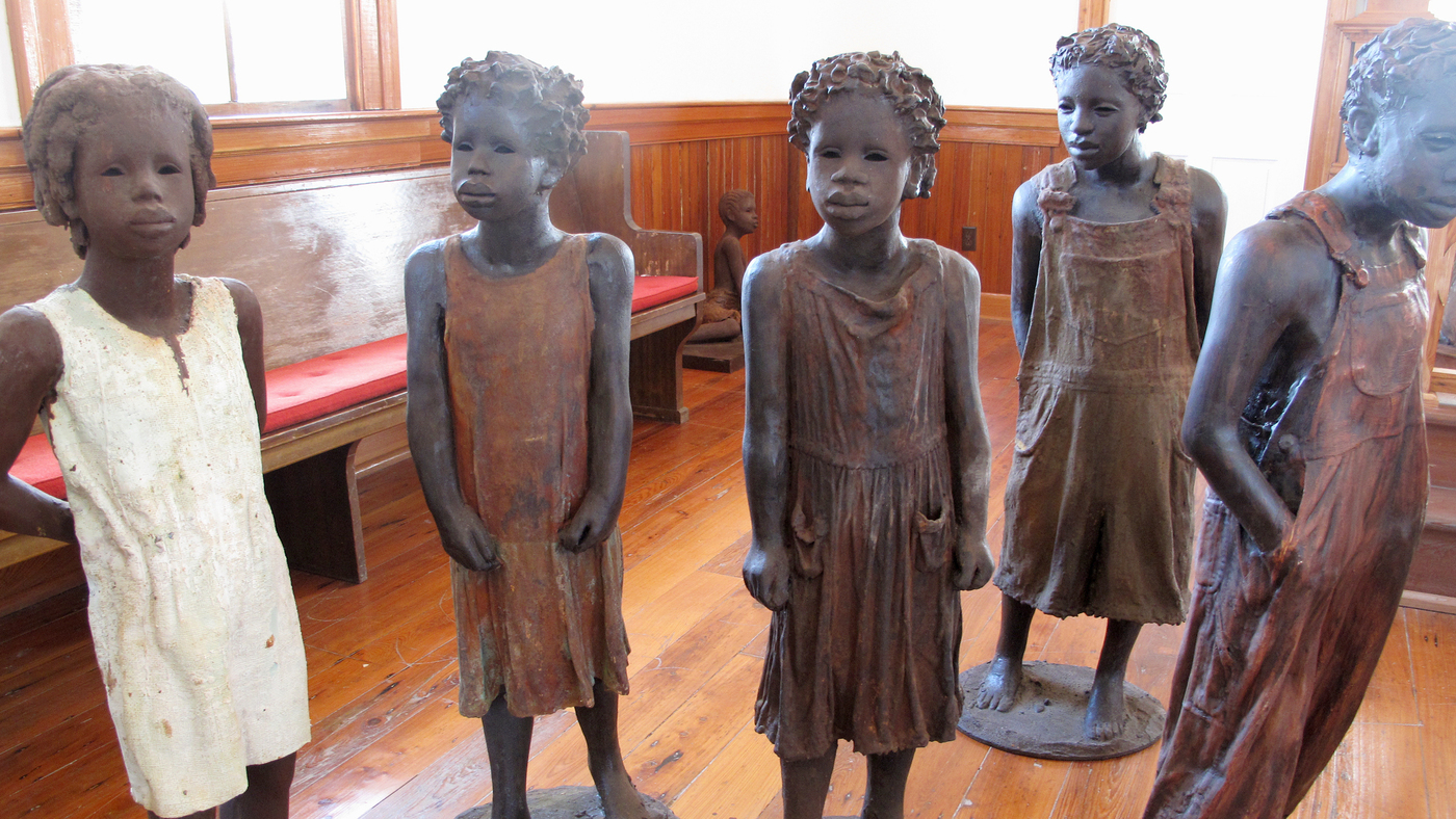 Whitney Plantation owner John Cummings has commissioned stark artwork for the site, including realistic statues of slave children found throughout the museum.