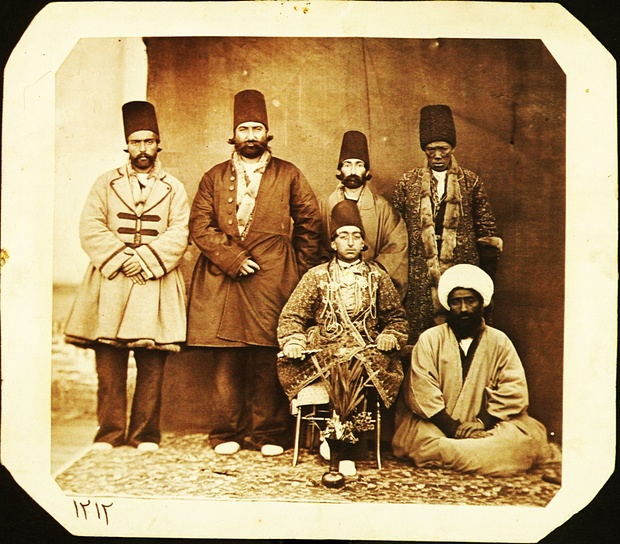 Muzaffar al-Din Mirza (Muzaffar al-Din Shah Qajar 1853-1907) accompanied by his entourage. Prince Muzaffar Mirza's high-ranking African slave (khajeh) is standing on his right, possibly in Tabriz, Iran, 1880s. Photograph: Unknown court photographer/Central Library, University of Tehran, Tehran, Iran