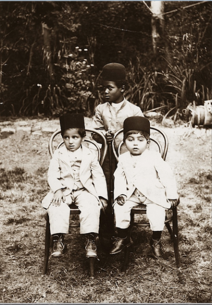 Qubad Il-khan Bakhtiari (right) and Hossein Il-khan Bakhtiari, sons of paramount Bakhtiar chief Il-khan Khosrow Zafar Bakhtiari, seated in a garden, probably in Isfahan, with their African slave, 1904. According to Khosronejad, this photo shows that slave ownership in Persia existed beyond the Qajar monarchy, and extended to tribal chiefs. Photograph: Institute for Iranian Contemporary Historical Studies, Tehran, Iran