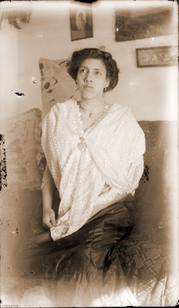 Eva O'Donnell was the daughter of James and Susan O'Donnell and was in a circle of card-playing friends who circulated to different homes to play canasta. The daughter of one of Eva's friends, Pamona Banks James, identified this portrait. Johnson chose to photograph Eva inside a home, instead of on a porch or in front of a backdrop