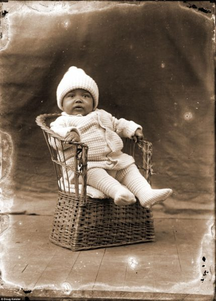 Historian Ed Zimmer said that discovering the history behind each of the photographs is incredibly important because by simply looking at a picture, viewers can get the story wrong. This unidentified, yet adorable baby is sitting in a woven chair and wearing a completely-knit outfit