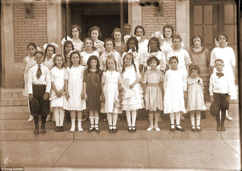 Johnson photographed these schoolchildren in front of Lincoln High School, though the children in the front rows do not appear to be high school age, though some of the girls in the front row are holding piano music. The University of Nebraska and Lincoln's public schools were integrated, though the public schools did not hire an African American teacher until the 1950s